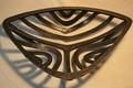 Triangular ripple fire basket